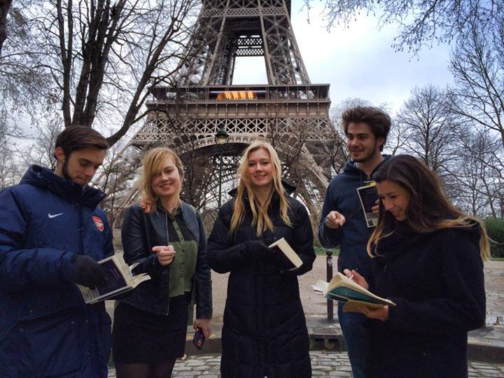 IAU College Great Cities J-Term students studying beneath the Eiffel Tower in Paris, France